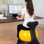 Businesswoman Sitting On Fitness Ball — Stock Photo #78446174