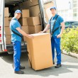 Workers Loading Boxes In Truck — Stock Photo #78446662