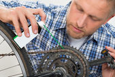 Man Oiling Bicycle Chain — Stock Photo