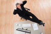 Businessman Relaxing On Chair — Stock Photo