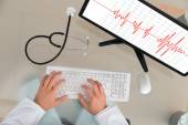 Doctor With Computer Showing Cardiogram — Stock Photo