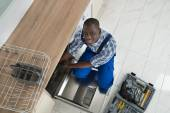 Repairman Repairing Dishwasher — Stock Photo