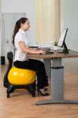 Businesswoman Sitting On Fitness Ball — Stock Photo