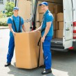 Two Movers Loading Boxes In Truck — Stock Photo #79915850