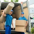 Workers Carrying Carpet And Cardboard Boxes — Stock Photo #79916266