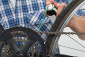 Person Hands Lubricating Bike — Stock Photo
