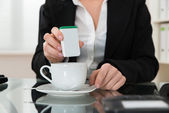 Close-up Of Businesswoman Putting Sugar In Cup — Stock Photo