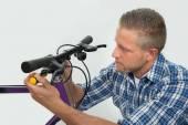 Man Tightening Bolt Of Bicycle Wheel — Stock Photo