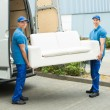 Workers Putting Furniture And Boxes In Truck — Stock Photo #80378462