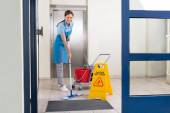 Worker Cleaning Floor With Mop — Stock Photo