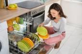 Woman Arranging Plates — Stock Photo