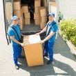 Two Movers Loading Boxes — Stock Photo #80380194