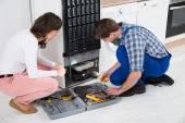 Repairman Repairing Refrigerator — Stock Photo