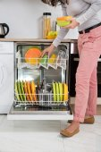 Woman Removing Bowls From Dishwasher — Stock Photo