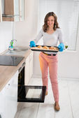 Woman Holding Baking Tray With Bread — Stock Photo