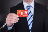 Businessman Holding Gift Card — Stock Photo