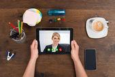 Person Videochatting On Digital Tablet — Stock Photo