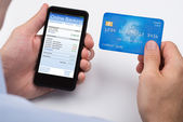 Person With Credit Card And Mobile Phone — Stock Photo