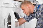 Handyman Repairing Washing Machine — Stock Photo