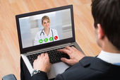 Businessperson Videochatting Online With Doctor — Stock Photo