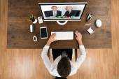 Businessman Videochatting With Senior Colleagues — Stock Photo
