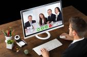 Businessman Online Videochatting With Colleagues — Stock Photo