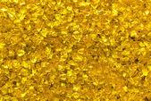 Golden glass granules background — Stock Photo