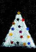Christmas tree decorate from glitter on black background — Stock fotografie