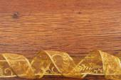 Golden curl ribbon frame  on wood  background — Foto de Stock