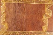 Golden curl ribbon frame  on wood  background — Стоковое фото