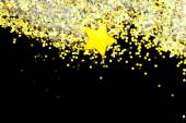 Golden glitter and star on black — Foto de Stock
