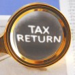 Tax return and magnifying glass — Stock Photo #63685701