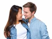 Happy young couple looking at each other — Stock Photo