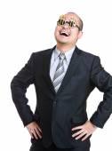 Happy businessman akimbo — Stock Photo