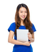 Chinese female with tablet — Stockfoto