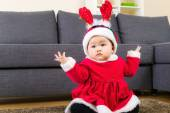 Little girl with christmas dressing — Stock Photo