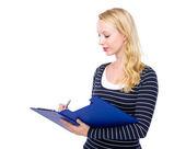 Woman write on clipboard — Stock Photo