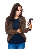 Woman looking at cellphone — Stock Photo