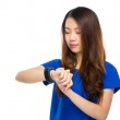 Woman looking at wearable watch — Stock Photo #55346285