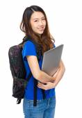 Student with schoolbag and laptop — Stock Photo