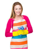 Housewife with kitchen gloves and towel — Stock fotografie