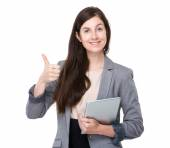 Businesswoman with tablet and thumb up — Stock Photo