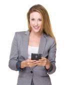 Businesswoman using cellphone — Stock Photo