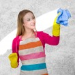 Young housewife cleaning dust — Stock Photo #57236455