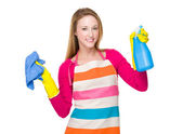 Housewife with rag and spray — Stockfoto