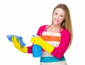 Housewife cleaning with rag and spray — Stockfoto