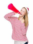 Woman shouting with megaphone — Stock Photo