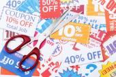 Money saving coupon vouchers with scissors — Stock Photo