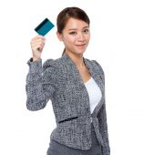 Businesswoman with credit card — Stock Photo