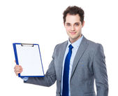 Businessman with blank paper on clipboard — Stock Photo
